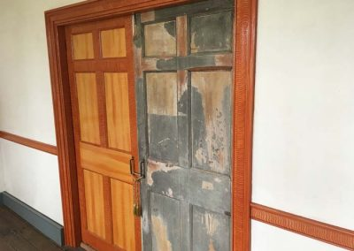 "Original pocket doors one restored, one in ""found"" condition."